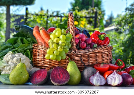 Fresh organic vegetables and fruits in the garden. Balanced diet - stock photo