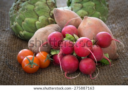 Fresh organic vegetables from a framers market on burlap - stock photo