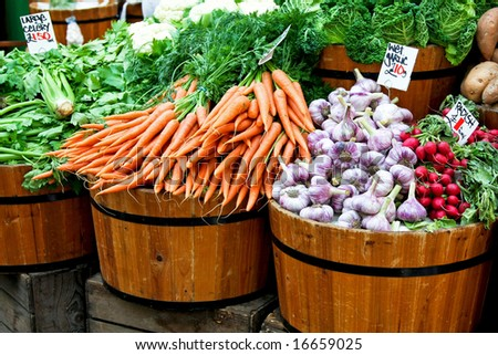 Fresh organic vegetables in big wooden buckets - stock photo