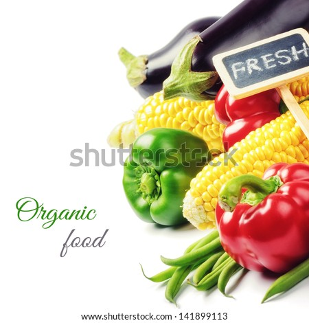 Fresh organic vegetables isolated over white - stock photo
