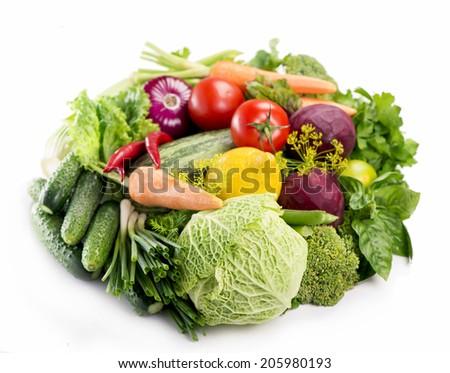 Fresh organic vegetables isolated over white  - stock photo