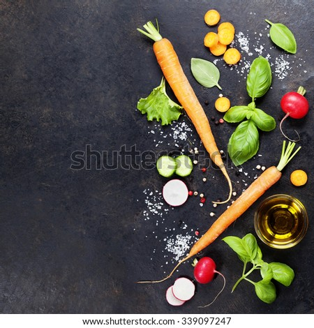 Fresh organic vegetables on dark rustic background. Healthy food. Vegetarian eating. Fresh harvest from the garden. Background layout with free text space. - stock photo