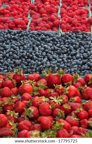 Fresh, organically grown berries - raspberries, blueberries, and strawberries - stock photo