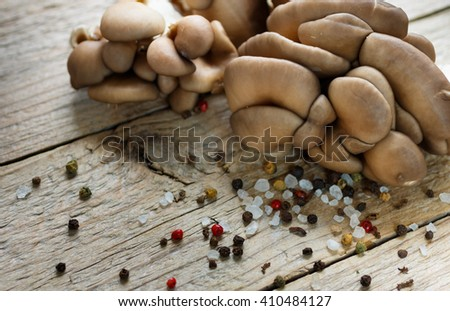Fresh oyster mushrooms on wooden table. Shallow depth of field - stock photo