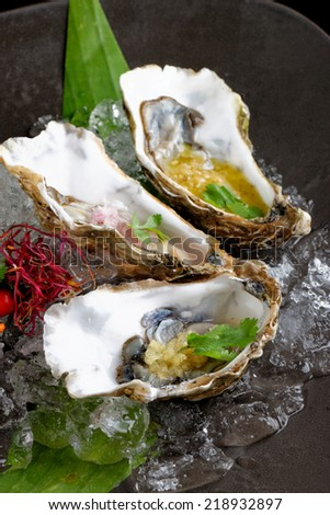Fresh Oysters with three sauces (cilantro with lime juice, ginger vanilla and pinneaple with chili) - stock photo