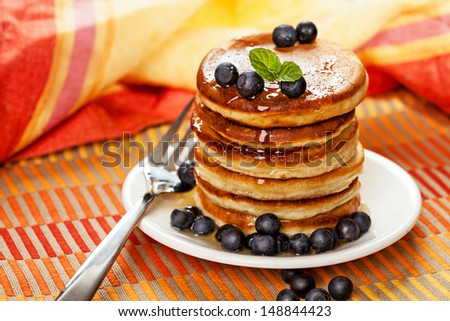 Fresh pancakes with blueberries and honey - stock photo