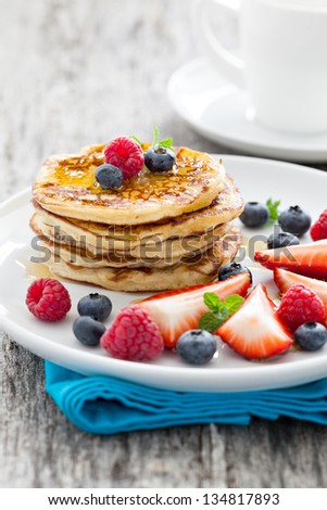 fresh pancakes with honey - stock photo