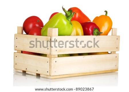 fresh paprica and tomatoes in wooden box isolated on white - stock photo