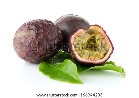 Fresh passion fruit with green leaves isolated on a white background - stock photo