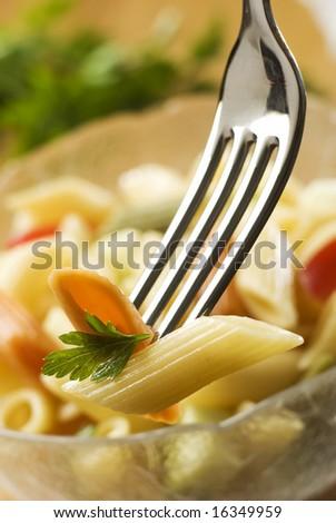 fresh pasta salad on fork close up shoot - stock photo