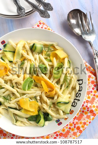 Fresh pasta with summer squashes - stock photo