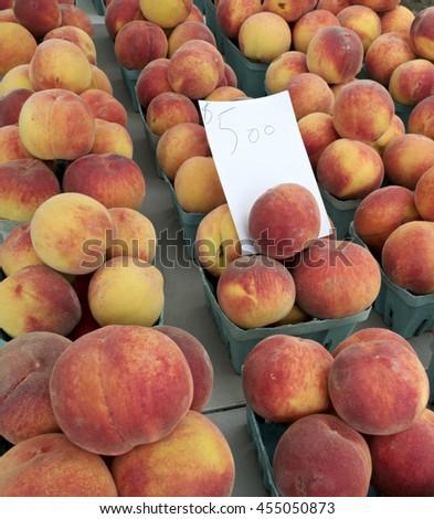 Fresh peaches for sale at farm market. - stock photo