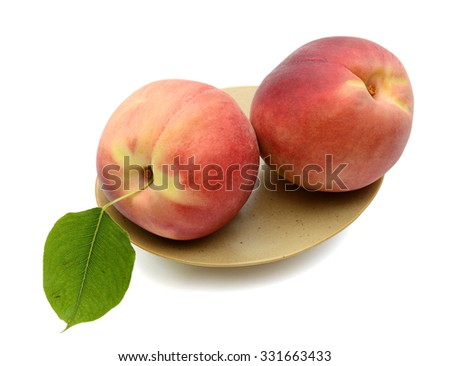 fresh peaches on plate isolated on white  - stock photo