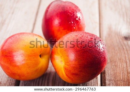 Fresh peaches on the table, delicious, juicy, tasteful - stock photo