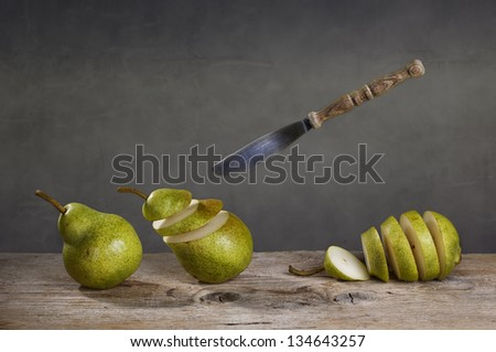 Fresh Pears being chased and cut to slices by flying knife - stock photo