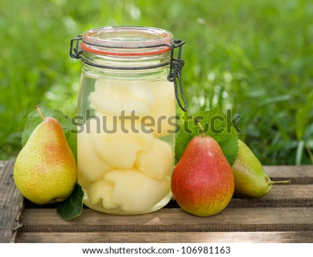 Fresh pears in preserving glass - stock photo