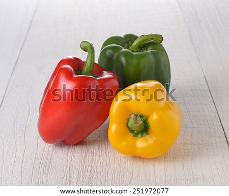 Fresh peppers on wooden - stock photo