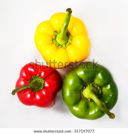 Fresh peppers. Three sweet Red, Yellow, Green Peppers isolated on white background. Top view - stock photo