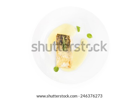 Fresh perch fish fillet with sauce on white plate isolated on white, top view. Exquisite eating, fine gastronomy. Luxurious seafood dinner and delicious fish eating.  - stock photo