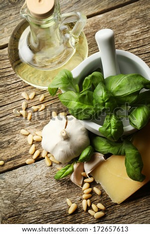 Fresh pesto with basil on wooden ground - stock photo