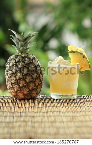 Fresh Pineapple Smoothie with slice of Pineapple  - stock photo