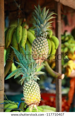 Fresh pineapples seen on a weekly fruit market - stock photo