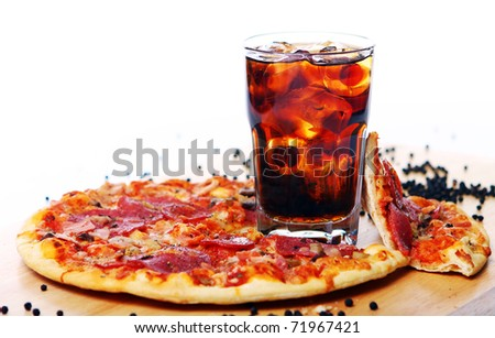 Fresh pizza with salami and mushrooms and cold cola drink - stock photo