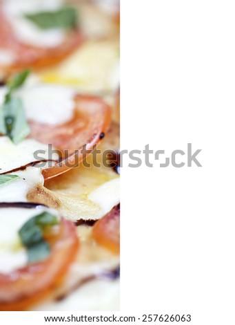Fresh pizza with tomato, mozzarella and basil on wooden board - stock photo