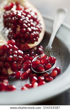 fresh pomegranate seeds - stock photo