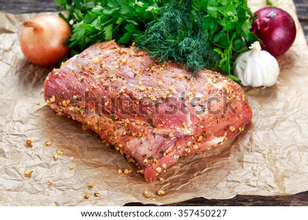 Fresh pork carbonade, meat marinated and prepared for roast with garlic, herbs. - stock photo