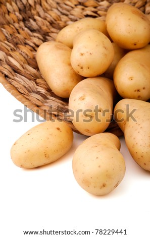 Fresh potatoes in a basket, white background - stock photo