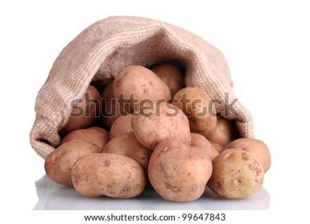 fresh potatoes in the bag isolated on white - stock photo