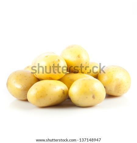 Fresh potatoes on a white background. - stock photo