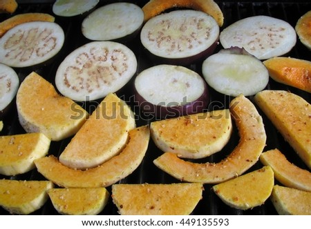 Fresh pumpkin and eggplant slices on the grill pan. - stock photo