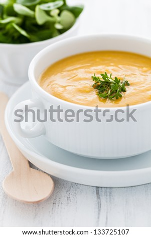 fresh pumpkin soup in a bowl - stock photo