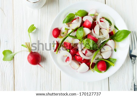 Fresh radish in a salad, food closeup - stock photo