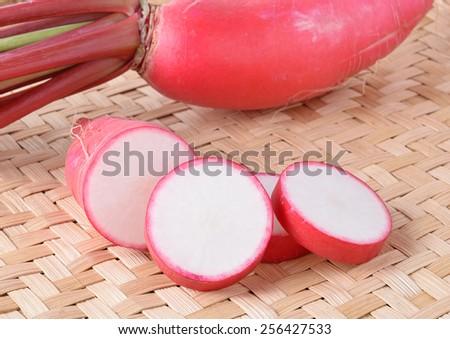 fresh radish on wooden table - stock photo