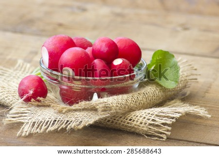 Fresh radishes in a bowl  - stock photo