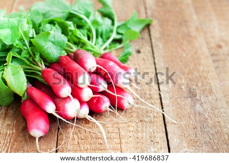 Fresh radishes on wooden background. Selective focus, with copyspace - stock photo