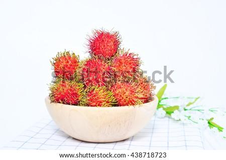 Fresh rambutan on table with tablecloth,Thai rambutan - stock photo