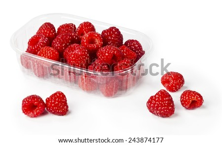 fresh raspberries from forest in plastic container - stock photo