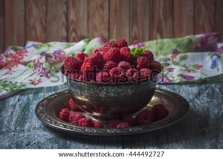 Fresh  raspberries in vintage basket, vitamins, healthy food, vegan ingredients. Selective focus - stock photo