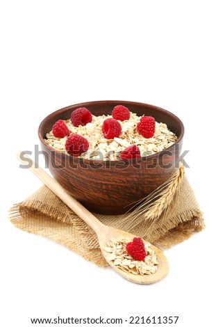 Fresh raspberry and Oatmeal flakes isolated on white background. Healthy food.  - stock photo
