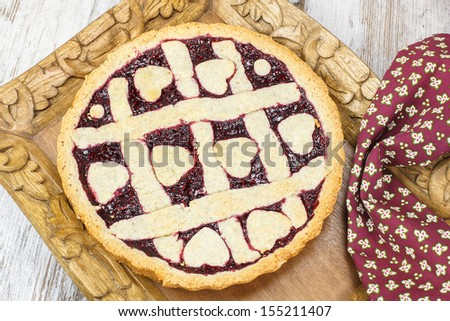 Fresh raspberry pie. Fresh Baked Berry Pie with Lattice Crust. Pastry heart on top - stock photo