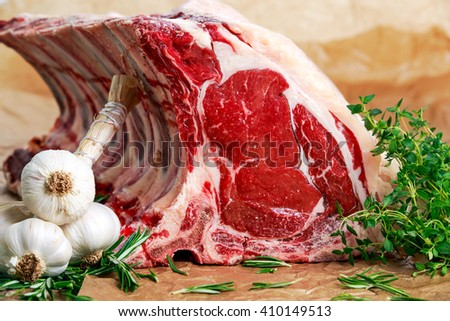 Fresh Raw Beef bone rib roughly choppid. with herbs. - stock photo