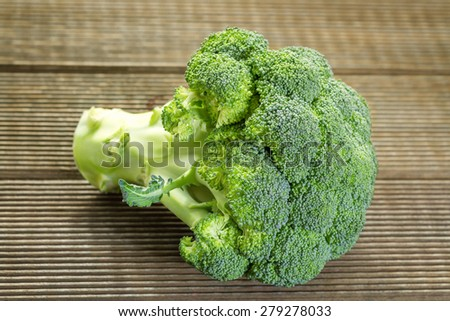 Fresh raw broccoli on a wooden table - stock photo