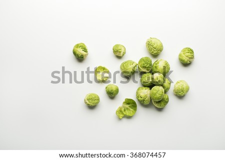 Fresh raw Brussels sprouts isolated on a white background. - stock photo