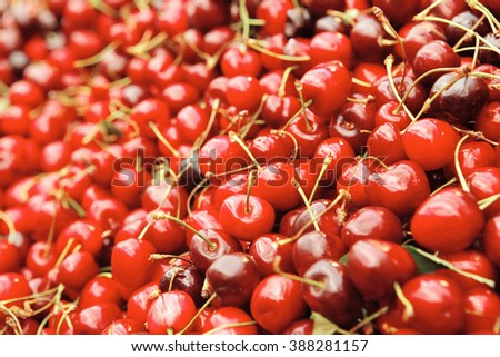 fresh raw cherry tasty heap taked now from market to you table for enjoy - stock photo