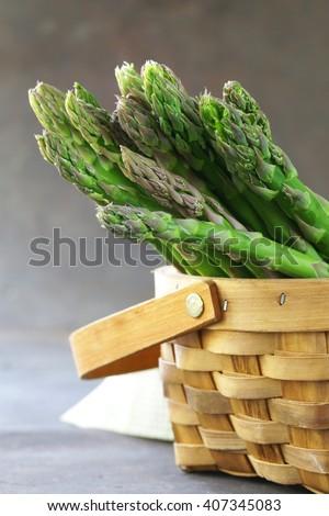 Fresh raw green asparagus, spring vegetables - stock photo