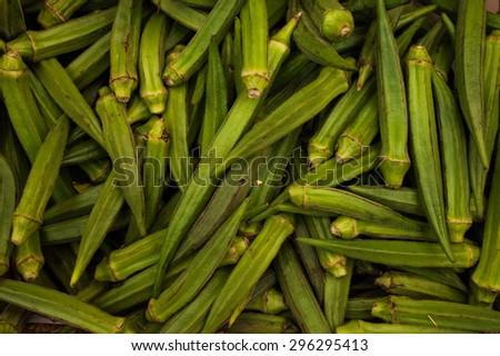 Fresh Raw Green Lady Finger - Okra sold on market  - stock photo
